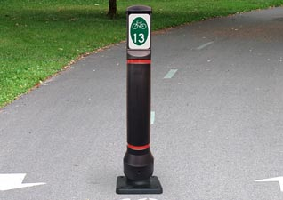 Glasdon, Inc. bolt down Neopolitan Signhead bollard with bicycle route sign face