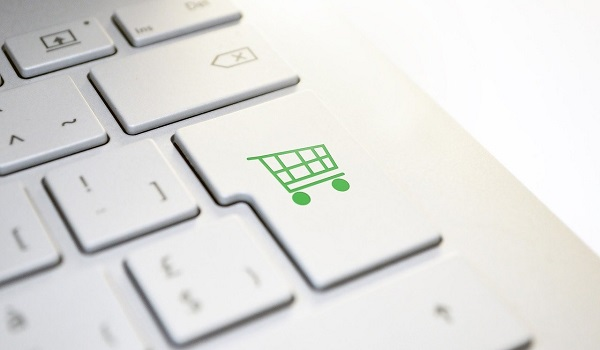 Image of keyboard and shopping cart for online shopping FAQs - Glasdon