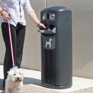 Dog owner using the Retriever City Pet Waste Station with dog on lead