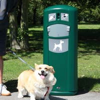 Happy dog in front of the Retriever City Pet Waste Station