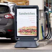 Advocate™ Poster Display Stand in use at gas station