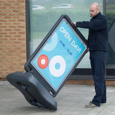 Moveable poster display stand